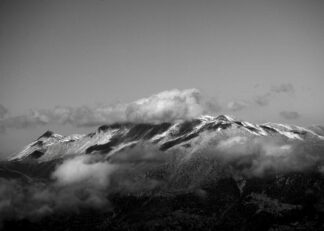 Swiss mountain peaks with clouds poster