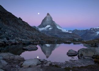 Matterhorn and Riffelsee lake at twilight with full moon poster
