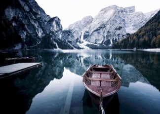 Wooden boat at alpine lake poster