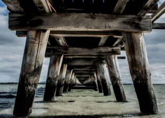 View underneath of a long jetty in Australia poster