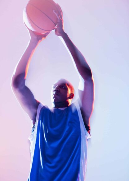 Basketball player in pitching pose poster