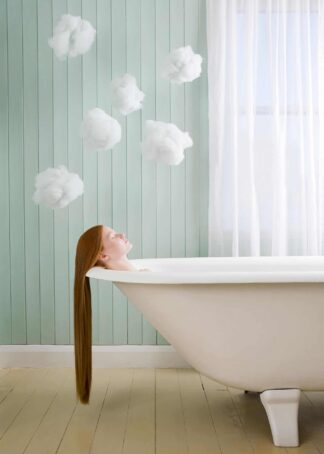 A girl with long hair relaxing in the bath poster
