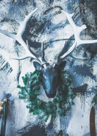 A decorative deer head poster