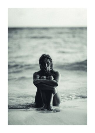 Girl sitting on the beach poster
