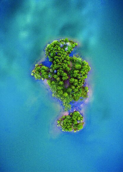 Island surrounded by body of water poster