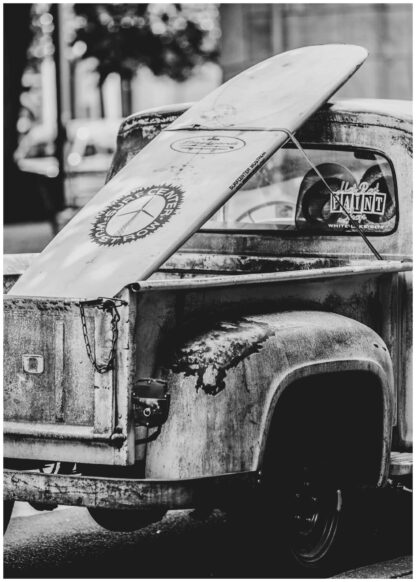 Surf board on pickup poster