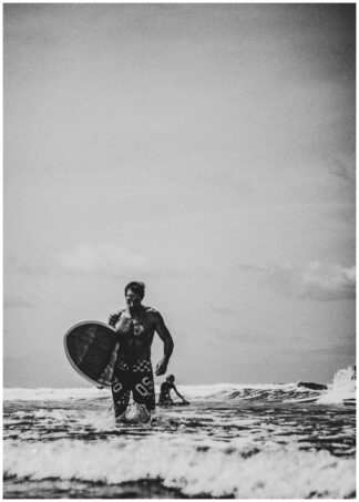 Surfer walking with board poster