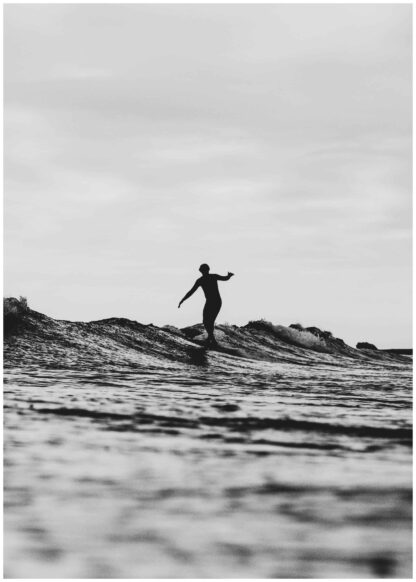 Stepping on a wave surfer poster