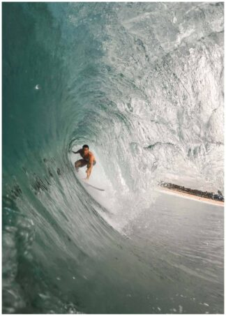 Surfer in a big wave poster